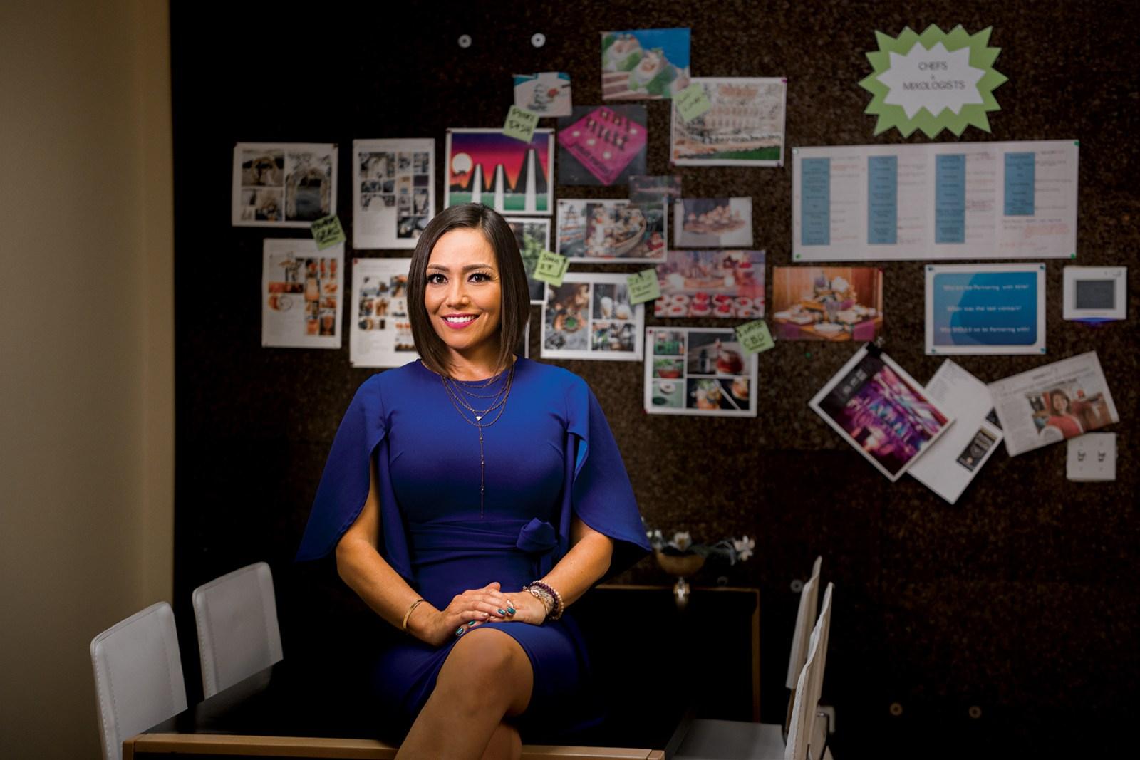 female in blue dress in office